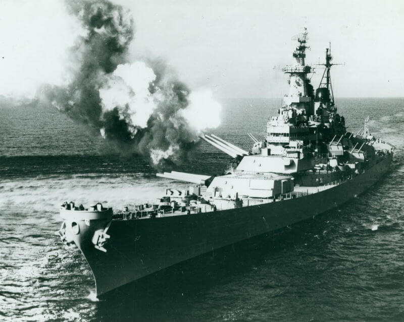 The Battleship Missouri firing 16 inch shells