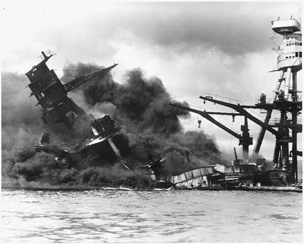 USS <em>Arizona</em> (BB-39) exploded and sank during the attack on Pearl Harbor. She was stricken from the Naval Vessel Register one year later