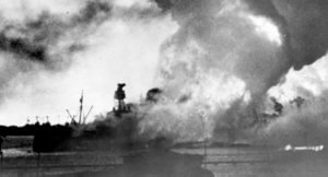 USS Vestal is visible to the left of the burning USS Arizona