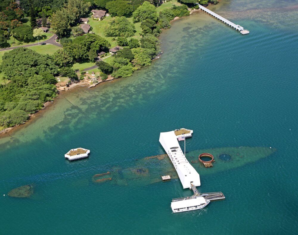USS Arizona Memorial straddles the wreckage of the sunken battleship
